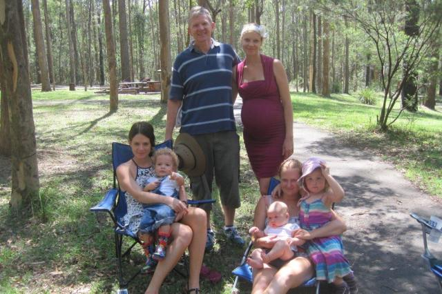 David with his daughters and grandchildren on his 60th